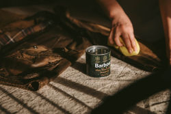 Image of a rewaxing can from Barbour