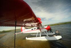 Float plane landing on water in Alaska