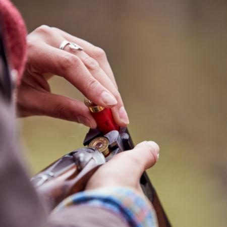 Man loading two shells into a shotgun