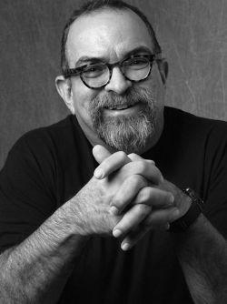 Black and white portrait of Alberto Rey
