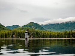 Man casting a fly rod in Alaska