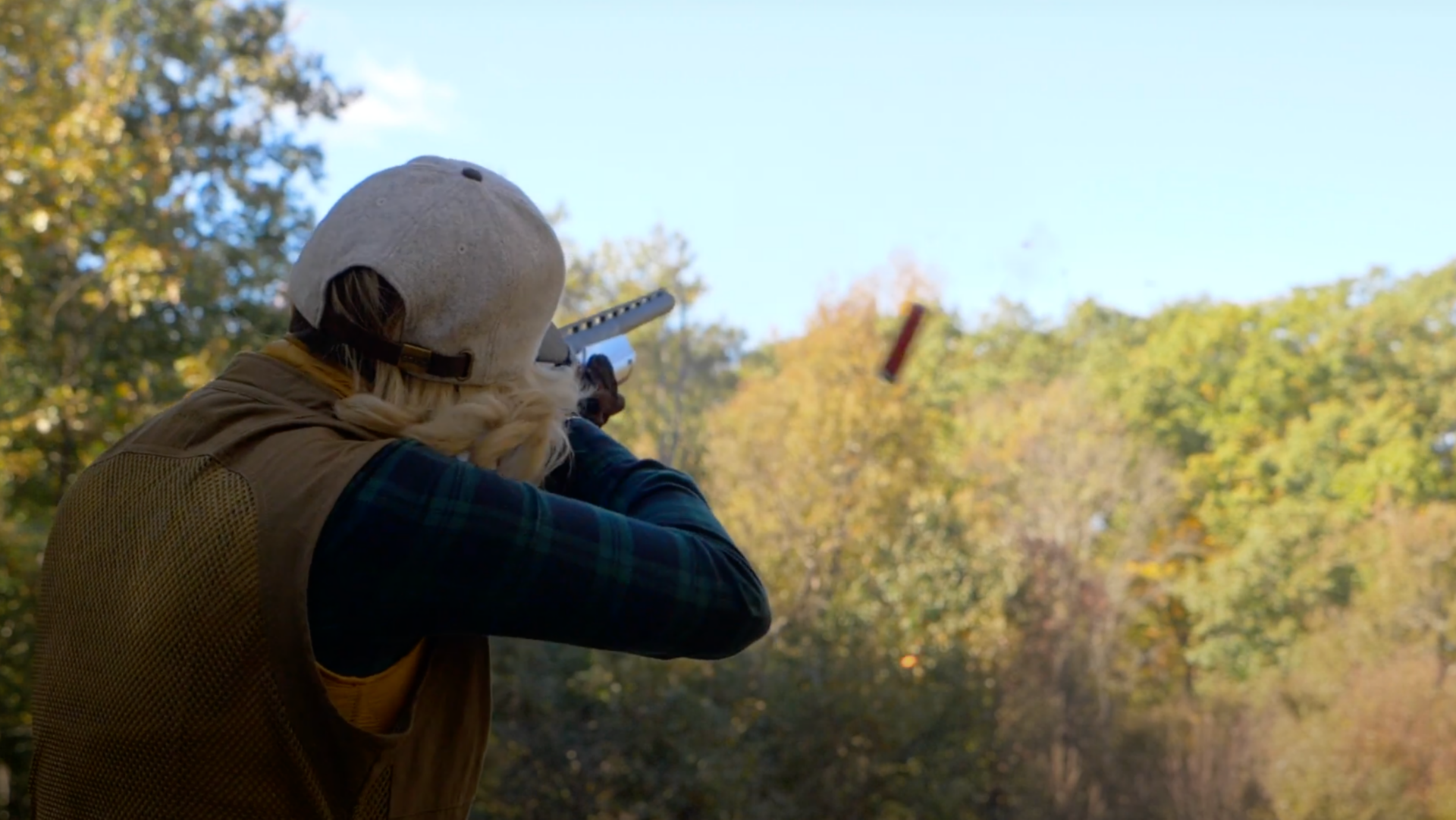 Woman shooting clays off a stand for the Orvis Cup